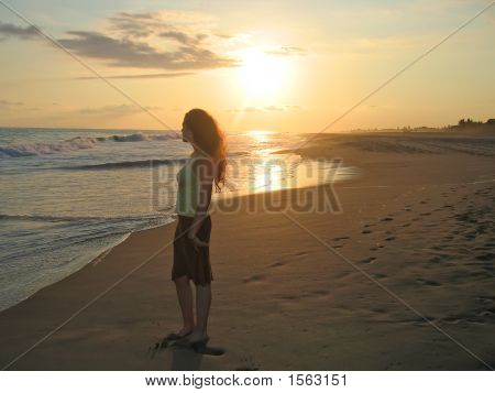 A Woman Standing On A Tropical Beach During The Sunset, Puerto Angel, Mexico