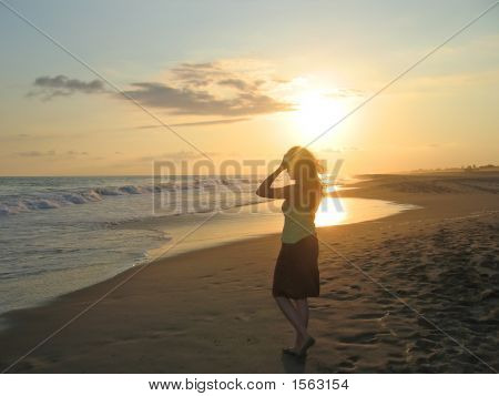A Woman With Hands On Her Head On A Tropical Beach During The Sunset, Puerto Angel, Mexico
