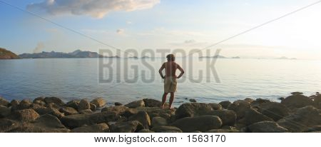 A Man Looking Over The Infinite Tropical Sea And Island Archipelago, Labuan Bajo, Pede Beach, Flores