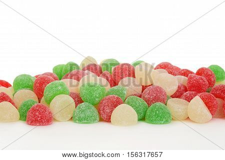 pile of christmas gum drop candy with white background