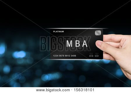 hand picking MBA or Master of Business Administration platinum card on blur background