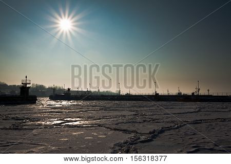 Freezed Dock With Boats At Sunrise In Winter