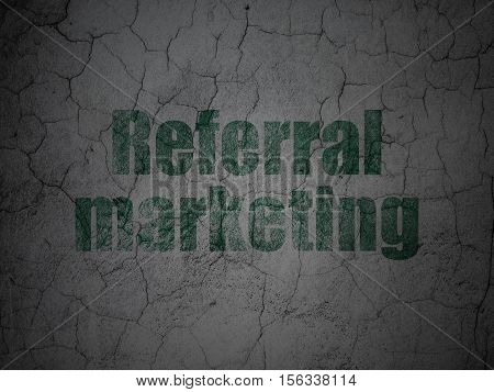 Marketing concept: Green Referral Marketing on grunge textured concrete wall background
