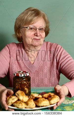 senior grannie with glasses with pies and mushrooms can close up portrait