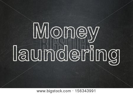 Money concept: text Money Laundering on Black chalkboard background