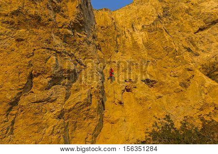 Rock climber on a steep rock. Cape Alchak Crimea.