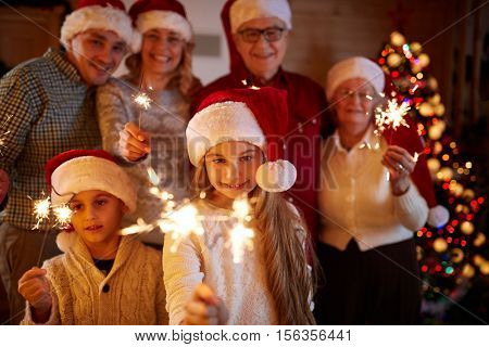 happy family with sparklers celebrate Christmas eve
