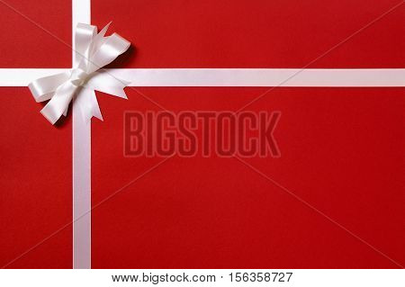 Gift Wrap, White Ribbon Bow, Red Paper Background, Copy Space