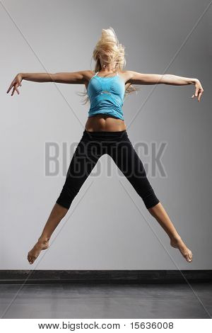 young stylish woman dancing modern dance