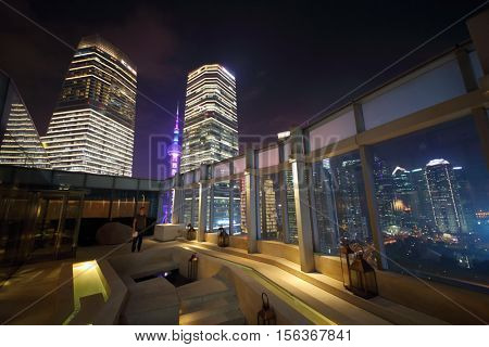 SHANGHAI, CHINA - NOV 5, 2015: Terrace and view of Oriental Pearl from IFC residence hotel at night, Shanghai - financial and commercial center of China