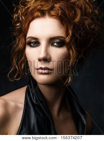 Portrait Of Red-haired Woman In A Leather Jacket On A Dark Background