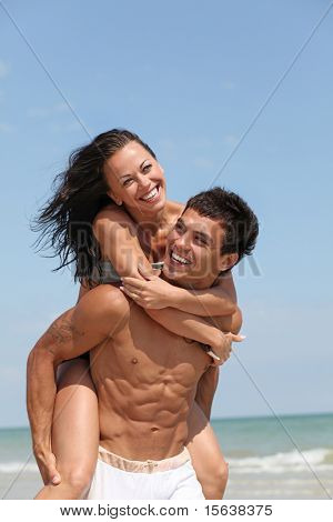 beautiful couple posing on the sandy sea coast