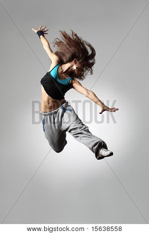 modern dancer poses in front of the white background