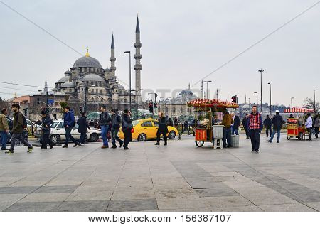 Istanbul Turkey - February 21 2013: Eminonu square. New Mosque (Yeni Cami) Istanbul Turkey. The Yeni Cami ; originally named the Valide Sultan Mosque and later New Valide Sultan Mosque after its partial reconstruction and completion between 1660 and 1665;
