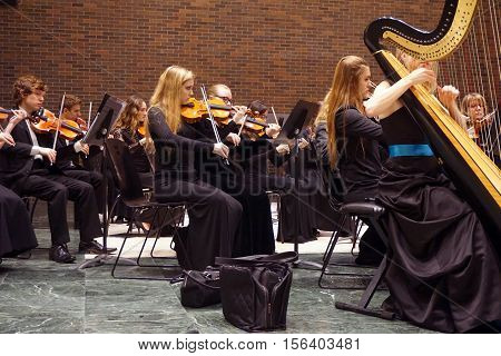ROMEOVILLE, ILLINOIS / UNITED STATES - OCTOBER 26, 2016: The Metropolitan Youth Symphony Orchestra (MYSO) rehearses prior to a concert at Lewis University.