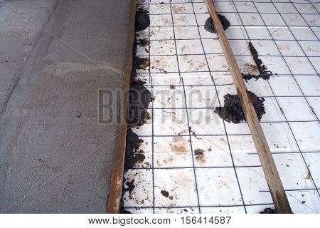 Insulating floor with polystyrene and concrete work place