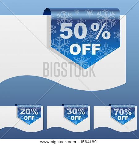 Winter sale discount labels bent around paper edge with snowflake shapes.