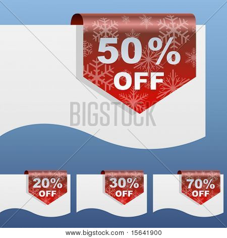 Red winter sale discount labels bent around paper edge with snowflake shapes.