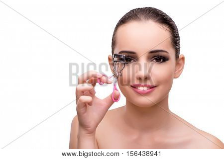 Young woman with eyelash curler isolated on white