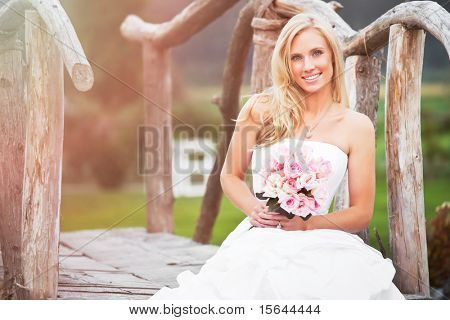 A shot of a beautiful caucasian bride sitting outdoor