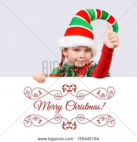 Girl Santa's elf showing sign OK with the banner. Background for your Merry Christmas and Happy New Year projects.