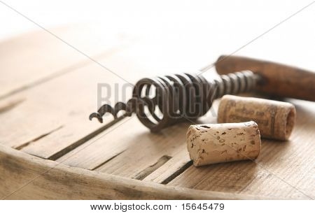 Corkscrew and two corks