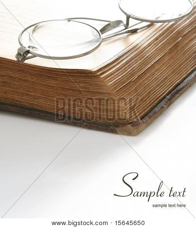 old eyeglass on a old book