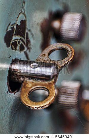 Old clock winder key taken closeup.Toned image.