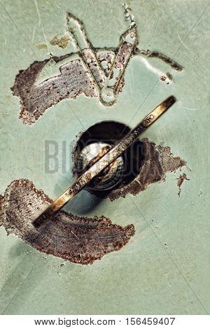 The Old clock winder key taken closeup.