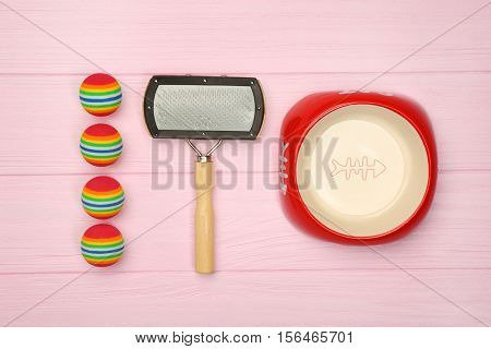 Pet accessories on wooden background