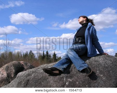 Girl Sitting On The Stone 2