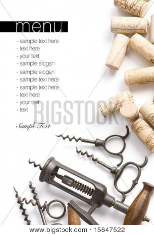Winery menu project. Unique old corkscrews & corks on white table cloth. Space for text isolated on white.