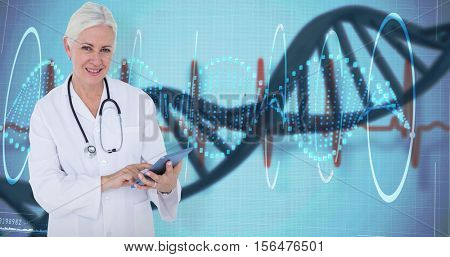 Smiling female doctor using table computer against device screen with blue dna helix pattern