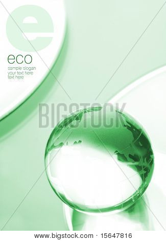 Globe made of glass on green leaf. Space for text isolated on solid white color.