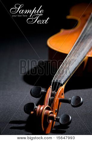 Old violin. Space for text isolated on black
