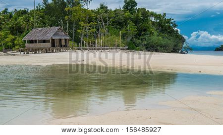 Empty Water Hut on Sand Bank between Kri Island and Monsuar. Raja Ampat, Indonesia, West Papua.
