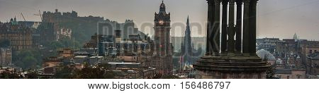 Calton Hill in Edinburgh Scotland. Aerial view of the city with Castle and Clock Tower. Day cloudy sky