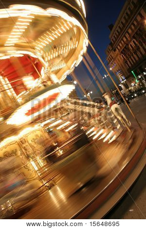 merry-go-round twisting fast in the night with thousands lights