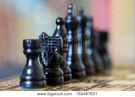 Close Up Of Black Chess Pieces With Blurred Background.