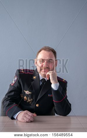 Smiling police lieutenant colonel in the form of