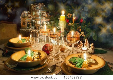 Christmas dinner table with Christmas atmosphere for the holidays