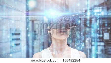 Digitally generated black and blue matrix against woman using reality virtual goggles