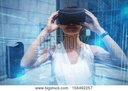 Illustration of virtual data against woman using virtual reality headset