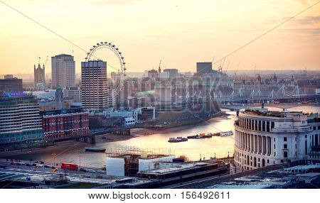 LONDON UK - 19 DECEMBER, 2015: London view at sunset. View at Westminster side of the city, river Thames, London eye and south bank walk