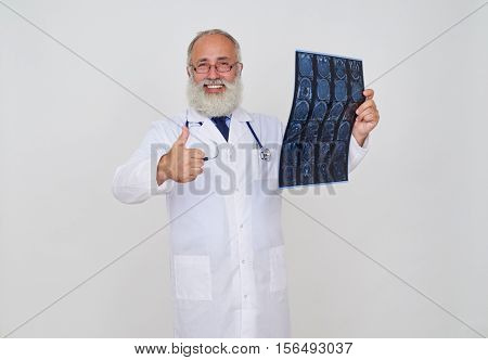 Smiling doctor making, ok gesture, while examining tomography results standing isolated against a white background