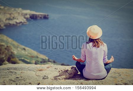 serenity and yoga practice in nature - woman exercising in mountains