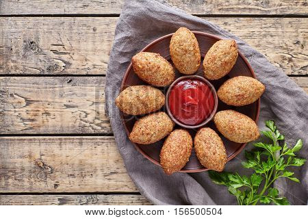 Kibbeh traditional middle eastern arabic lamb meat kofta meatball croquettes food on vintage wooden table background