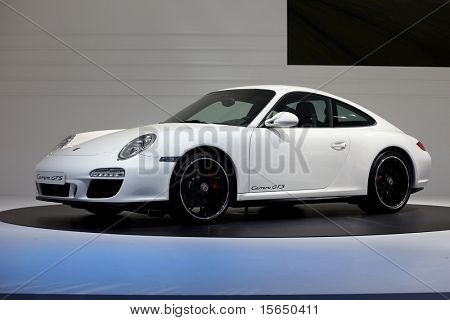 PARIS, FRANCE - SEPTEMBER 30: Paris Motor Show on September 30, 2010, showing Porsche 911 Carrera GTS, side view in Paris.