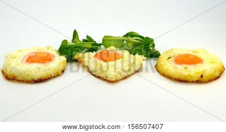 Egg trio on the plate with watercress salad on a white background
