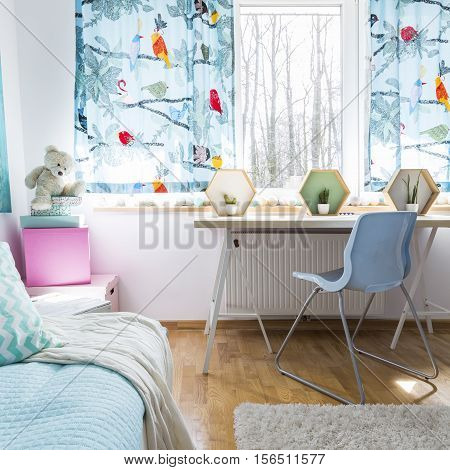 Bed, Desk And Window Overlooking Winter Forest